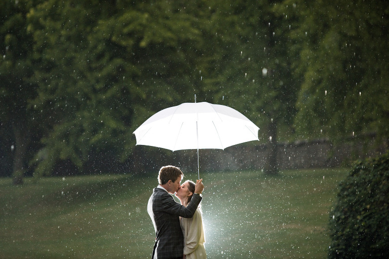 Professional Wedding photography of Bride & Groom in Wet Weather in Firle, East Sussex