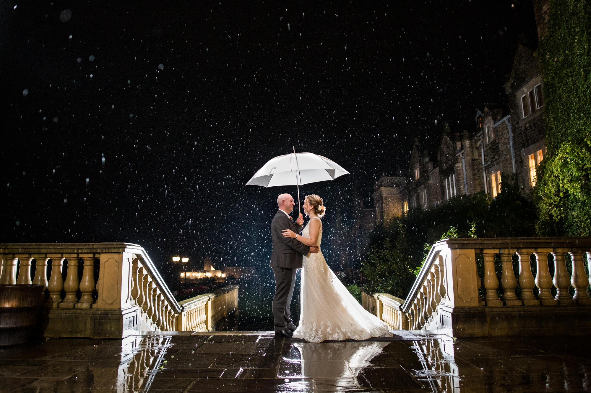 Professional Wedding Photograph in the rain at South Lodge Hotel in Horsham
