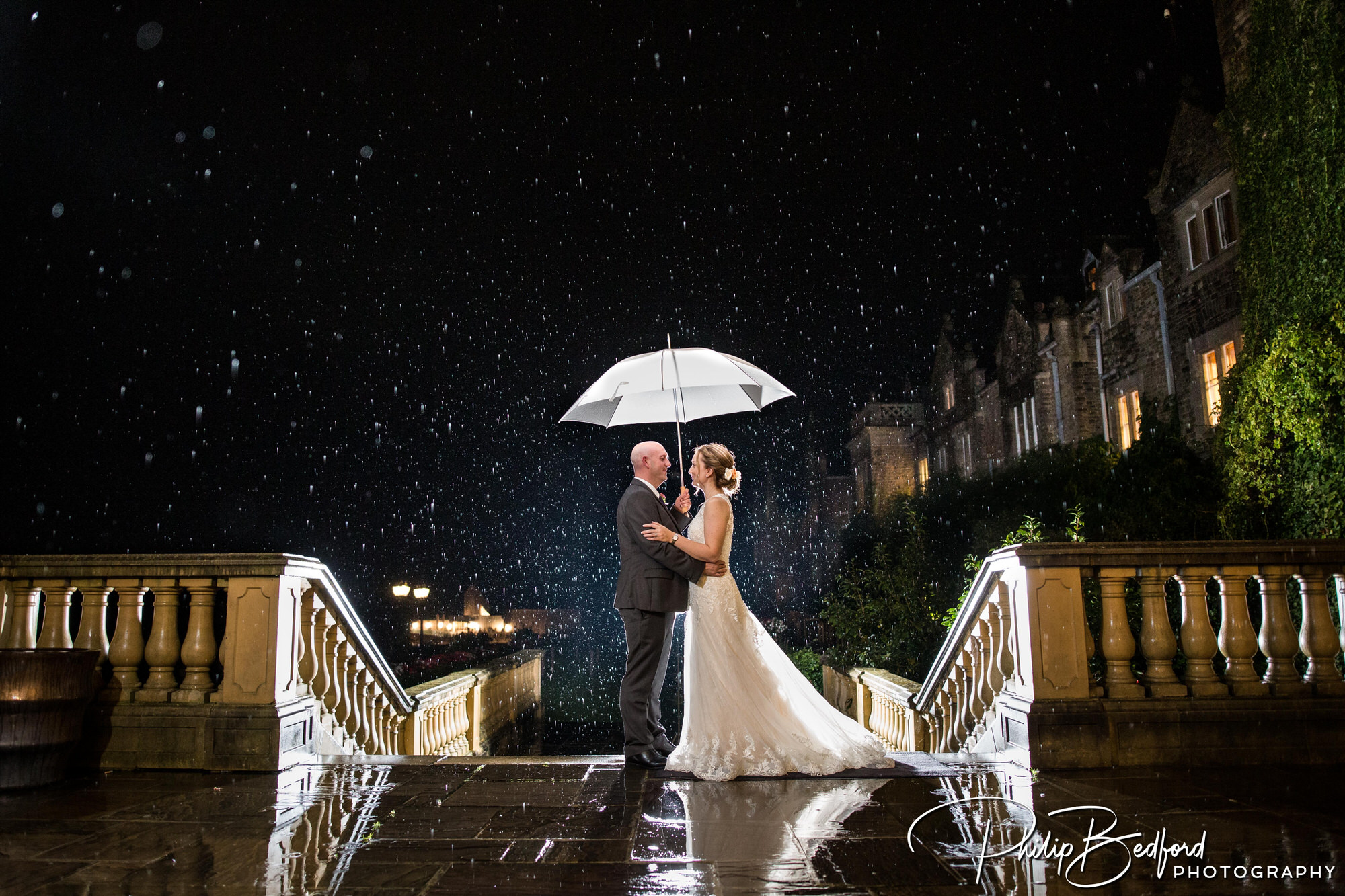 Reportage Wedding photograph of Bride & Groom in the rain