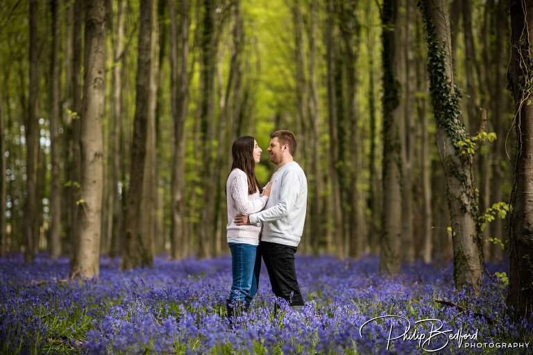 Man & Woman amongst Bluebells on a Engagement Shoot near Worthing, West Sussex